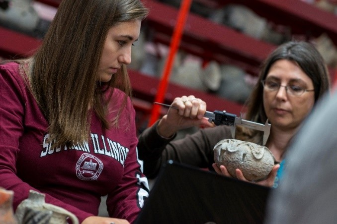 SIU Students measuring pottery